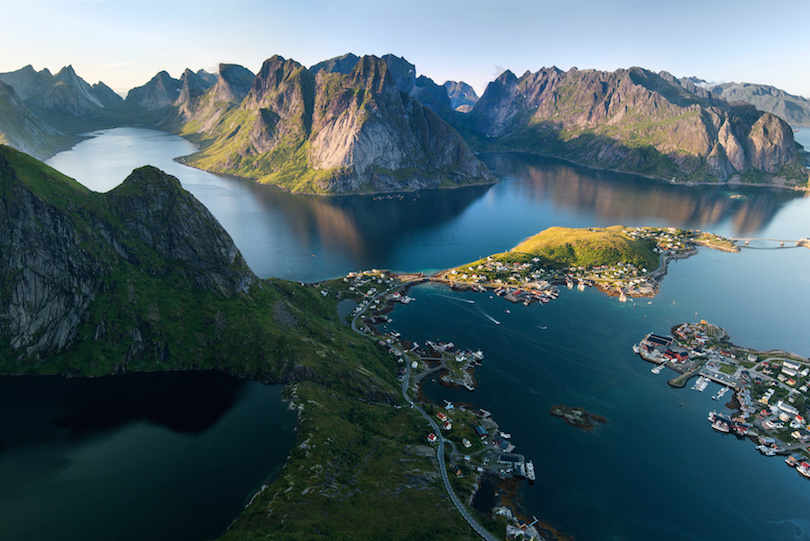 Scenic landscape of Lofoten islands: peaks, lakes, and houses