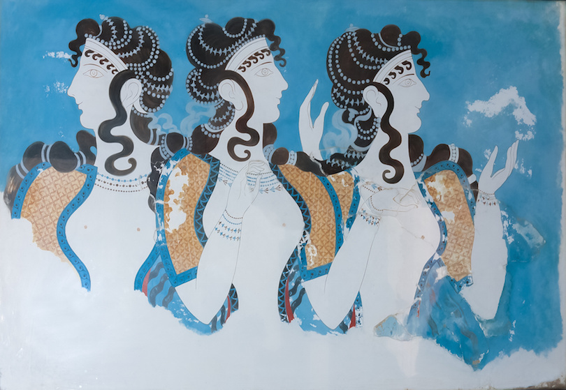 Aged fresco of three women profiles in Knossos