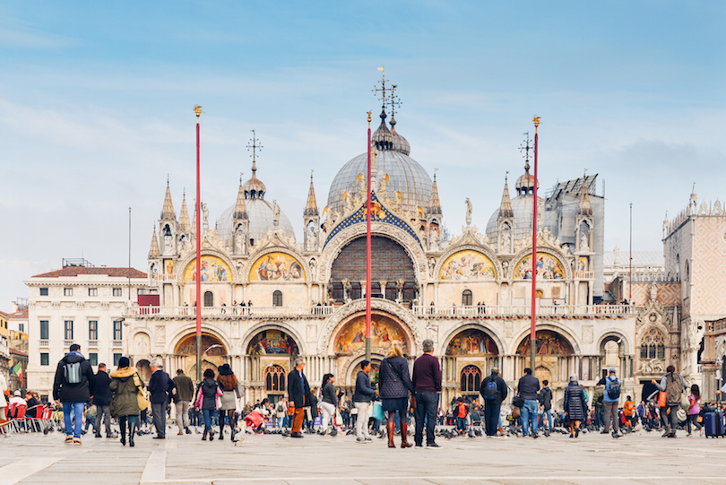 Tourists in Piazza San Marco in front of the basilica, Venice, Italy