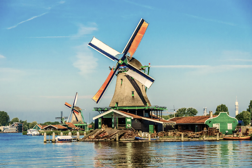 Dutch Windmills along the Zaan River at the village of Zaanse Schans in the Netherlands