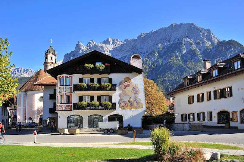 9b1551121f0fd Once there, you'll agree wholeheartedly that Mittenwald is, indeed, the  Bavarian Alps most beautiful village. Medieval buildings with color-laden  window ...